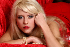 Beautiful and sexy blonde girl on red background Royalty Free Stock Image