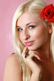 Beautiful sexy blonde with red flower in hair Royalty Free Stock Photos