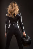 Beautiful and sexy blonde woman from back, with motor bike helmet Royalty Free Stock Image