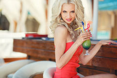 Beautiful sexy blonde woman in bar Stock Image
