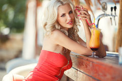 Beautiful blonde woman in bar royalty free stock photography