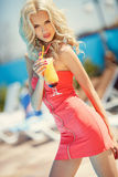 Beautiful blonde woman in bar stock image