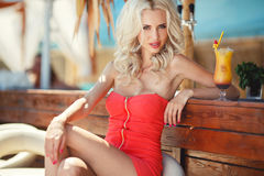 Beautiful sexy blonde woman in bar Stock Photography
