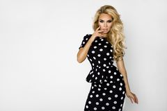 Beautiful, blonde woman in elegant clothes in polka dots. Beautiful, blonde woman girl model in elegant clothes in polka dots royalty free stock photos