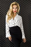 Beautiful, blonde woman in elegant clothes in polka dots. Beautiful, blonde woman girl model in elegant clothes in polka dots stock photos