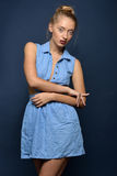 Beautiful sexy blonde woman in jeans dress. Studio shooting Stock Images
