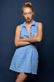 Beautiful sexy blonde woman in jeans dress. Studio shooting Stock Photo