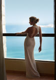 Beautiful and sexy blonde woman in white dress on  balcony Royalty Free Stock Photos