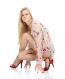 Beautiful sexy blondy in high red heels Stock Images