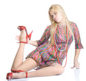 Beautiful sexy blondy in high red heels posing Stock Image