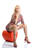 Beautiful sexy blondy in high red heels sitting Stock Photo
