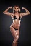 Beautiful bodybuilder in black bikini. Royalty Free Stock Photos