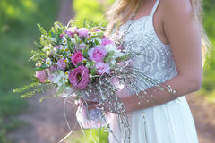 Beautiful bride . Young fashion bride holding a wedding bouquet royalty free stock images