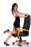 Beautiful sexy brunette on armchair isolated Royalty Free Stock Photography