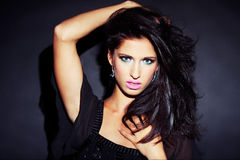 Beautiful and sexy brunette girl on dark. Background - portrait Royalty Free Stock Image