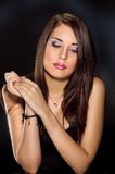 Beautiful and sexy brunette girl on dark. Beautiful Brunette Girl with Healthy Long Hair Royalty Free Stock Photo