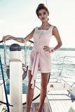 Beautiful sexy brunette girl in dress makeup summer trip yacht Stock Image