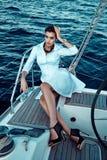Beautiful brunette girl in dress makeup summer trip yacht royalty free stock photo