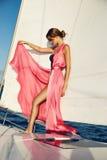 Beautiful brunette girl in dress makeup summer trip yacht stock photo