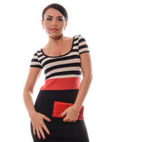 Beautiful brunette girl  with red purse posing in studio Stock Image