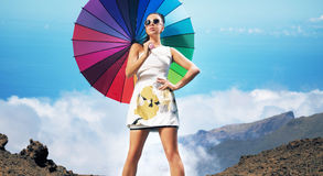 Beautiful sexy brunette holding colorful umbrella Stock Photos