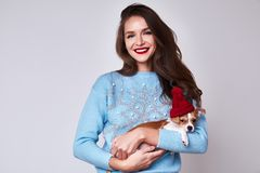 Beautiful sexy brunette long hair woman wear blue color sweater. With snowflake pretty face makeup celebrate new year eve party merry Christmas fun holiday Stock Photo