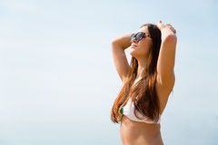 Beautiful sexy brunette takes a tan Royalty Free Stock Photo