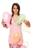 Beautiful brunette woman with balloons Royalty Free Stock Image