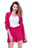 Beautiful sexy brunette woman business office style fashion clot. Hes summer collection perfect body shape pretty face makeup smile wear short pink jacket silk Stock Images
