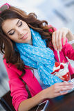 Beautiful Sexy brunette woman in Cafe. Beautiful sexy brunette woman in restaurant cafe with ice cream cake alluring woman in bright clothes and hairstyle and Stock Photos