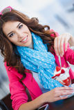 Beautiful Sexy brunette woman in Cafe. Beautiful sexy brunette woman in restaurant cafe with ice cream cake alluring woman in bright clothes and hairstyle and Royalty Free Stock Image