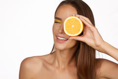 Beautiful brunette woman with citrus on a white background, healthy food, tasty food, organic diet, smile healthy Stock Photography