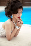 Beautiful brunette woman model in elegant fashion dress wit stock photography