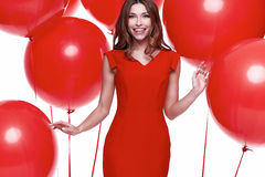 Beautiful sexy brunette woman skinny business style dress. Diplomatic red color perfect body shape busy glamour lady casual style hostess etiquette balloon Royalty Free Stock Photo