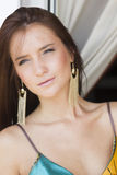 Beautiful sexy brunette woman in summer dress on the balcony Stock Images