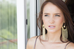 Beautiful sexy brunette woman in summer dress on the balcony Royalty Free Stock Photo