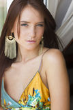 Beautiful sexy brunette woman in summer dress on the balcony Royalty Free Stock Photography