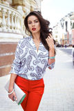 Beautiful sexy brunette woman walk clothes fashion party street Royalty Free Stock Photo