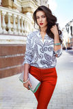 Beautiful sexy brunette woman walk clothes fashion party street Royalty Free Stock Photos