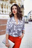 Beautiful sexy brunette woman walk clothes fashion party street Stock Image