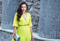 Beautiful sexy brunette woman walk silk dress party street Royalty Free Stock Photos