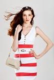 Beautiful caucasian woman in stylish dress Stock Image