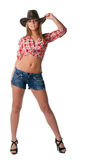 Beautiful sexy cowgirl stand in shorts isolated Royalty Free Stock Photos