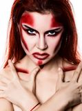 Beautiful devil girl with professional make-up. Fashion Art design. Attractive model girl in Halloween make up.  royalty free stock photo