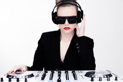 Beautiful sexy disc jockey at her deck Royalty Free Stock Images