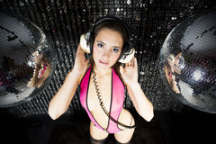 Beautiful sexy disco dj woman in lingerie surrounded by discobal Stock Photography