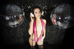 Beautiful sexy disco dj woman in lingerie surrounded by discobal Royalty Free Stock Photography