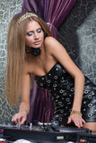 Beautiful and DJ girl on decks Royalty Free Stock Image