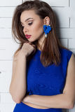 Beautiful sexy elegant fashionable woman with bright evening make-up with big lips plump demonstrates Handmade Jewelry in fashiona Stock Images