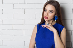 Beautiful sexy elegant fashionable woman with bright evening make-up with big lips plump demonstrates Handmade Jewelry in fashiona Stock Image